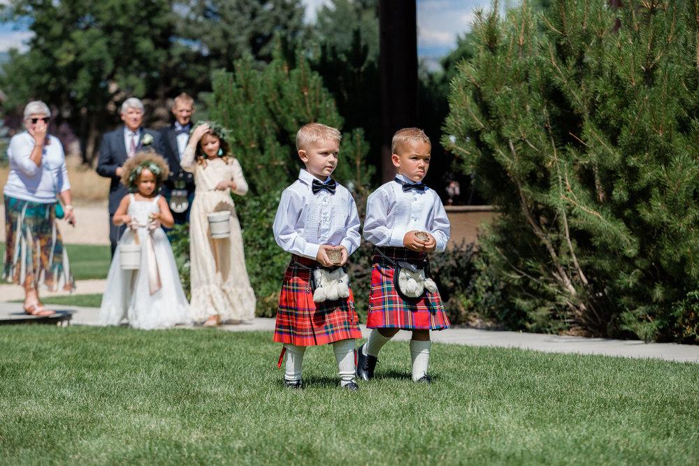 Scottish Ring Bearers during wedding ceremony