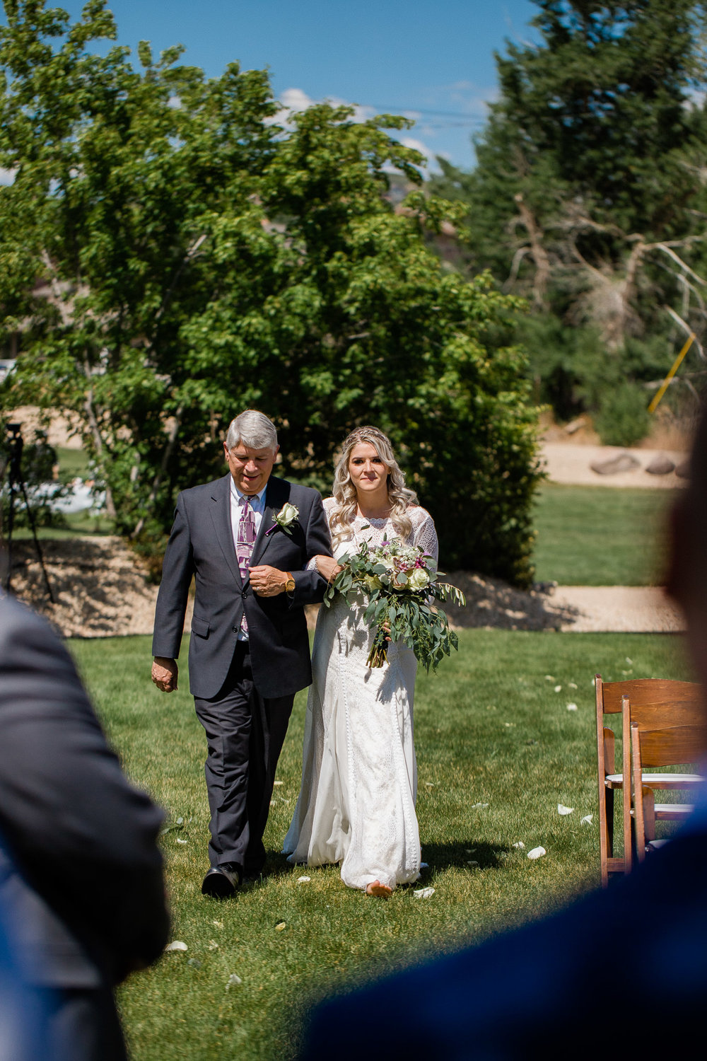 Bride and Father walking down aisle during wedding ceremony