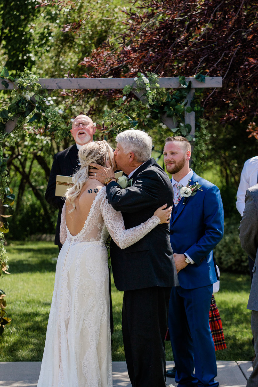 Bride and Groom during wedding ceremony at cabin in Utah Mountains