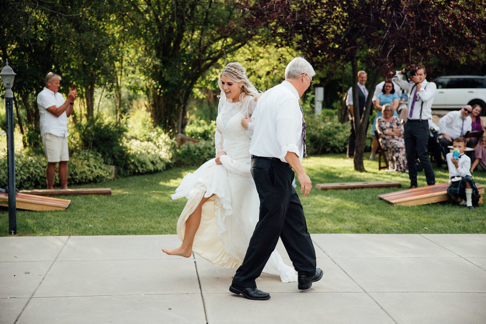 Bride dances with her father to bagpipes during wedding reception