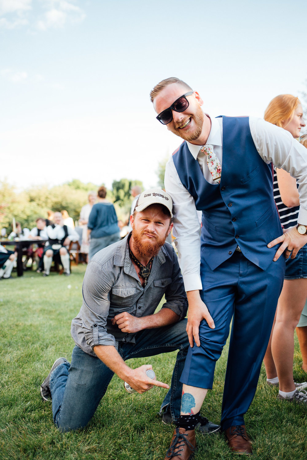 Groom and friend mingle during wedding reception