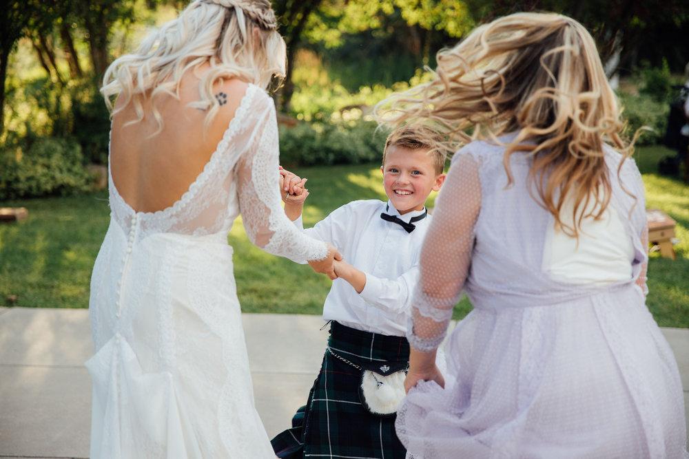 Bride dances with guests at wedding reception