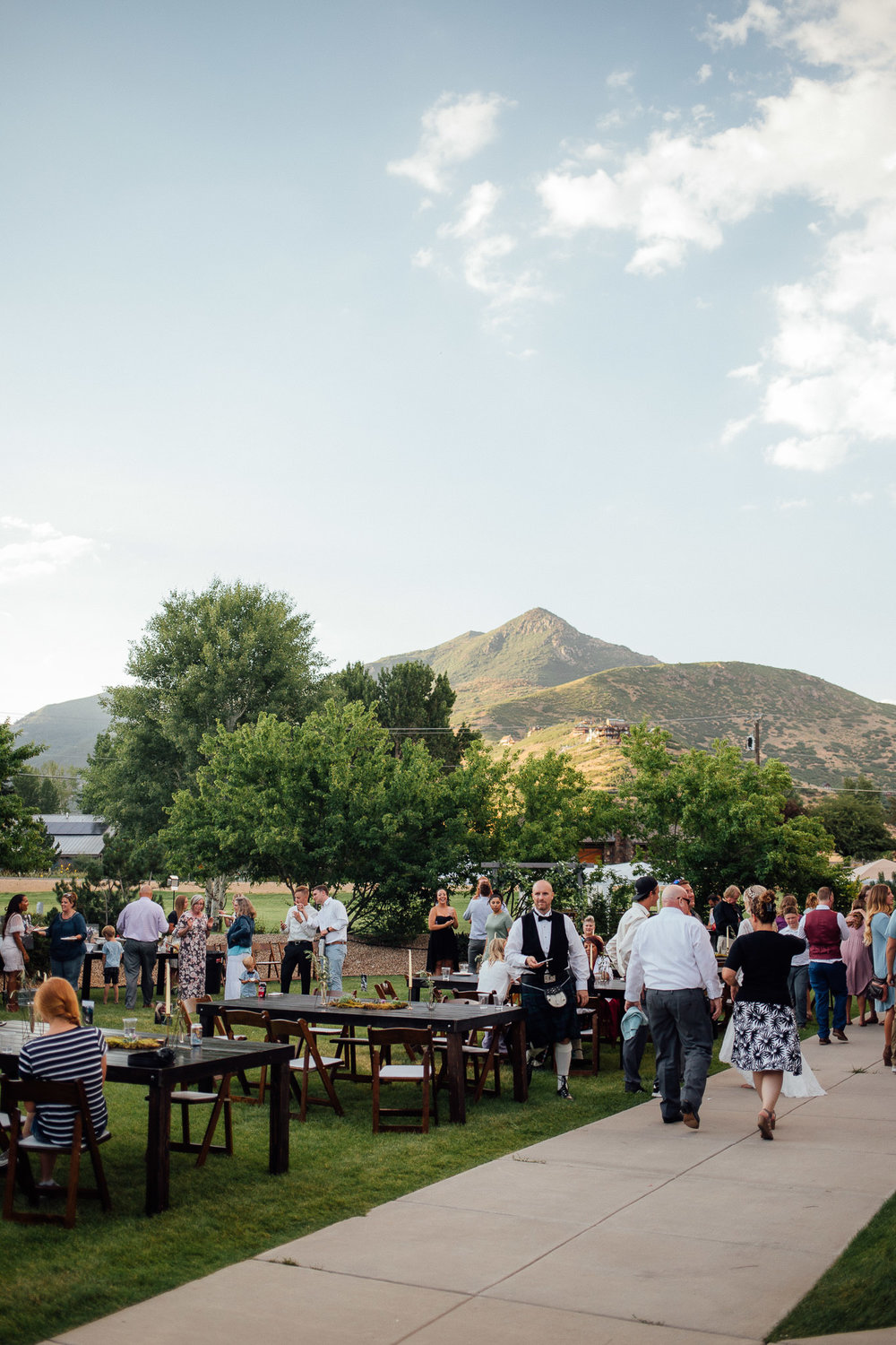 Guests dance during wedding reception with view of the Uintah Mountains