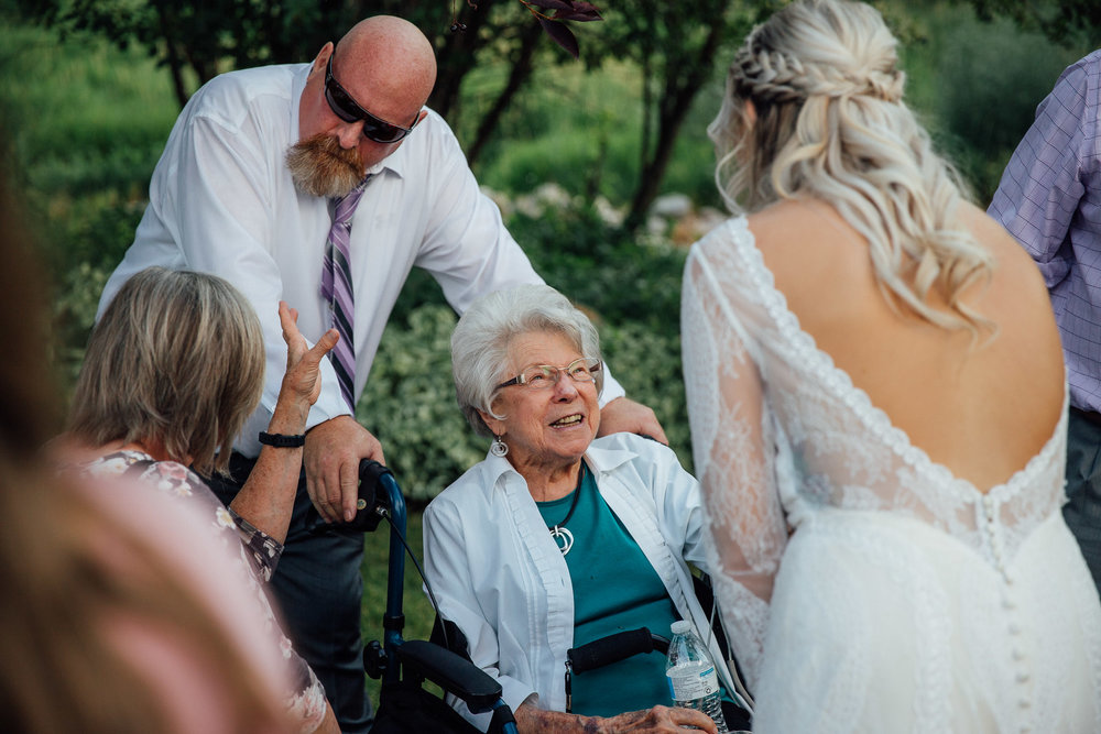 Bride visits grandma during wedding reception