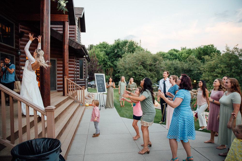 Bride tosses bouquet during wedding reception