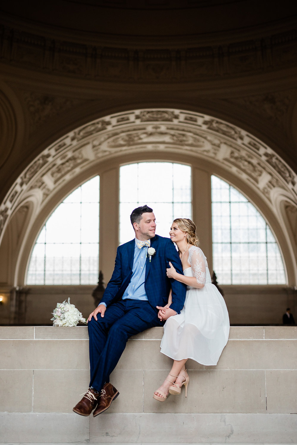 Bride and Groom posing for wedding portraits in San Francisco City Hall