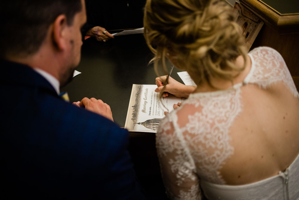 Bride and Groom meet with officiant in San Francisco City Hall
