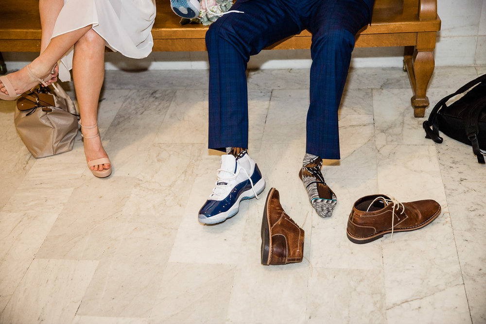 Bride and Groom change shoes after wedding ceremony