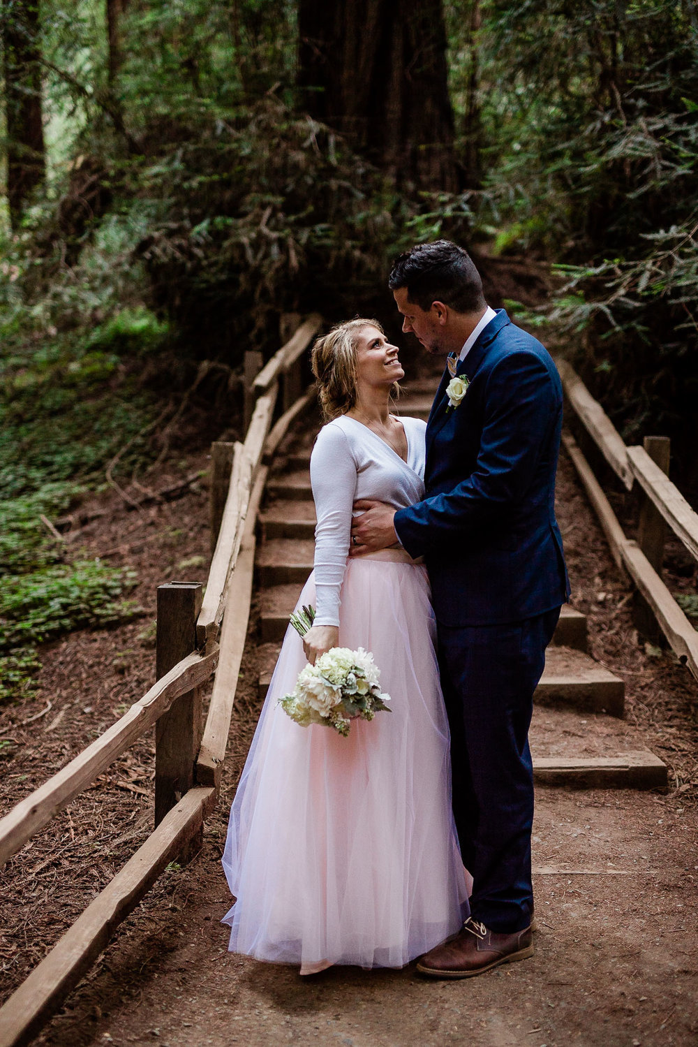 Bride and Groom pose for wedding photos in the Muir Woods National Monument