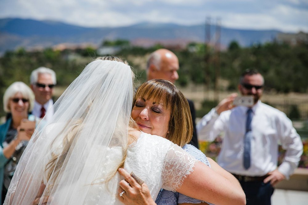Bride greets guests after Cedar City Temple wedding ceremony