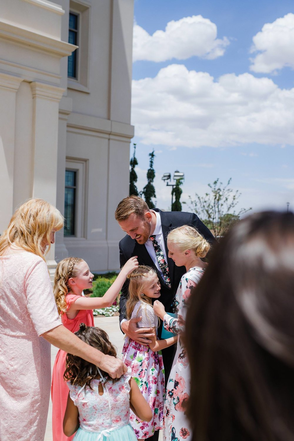 Groom greets guests after Cedar City Temple wedding ceremony