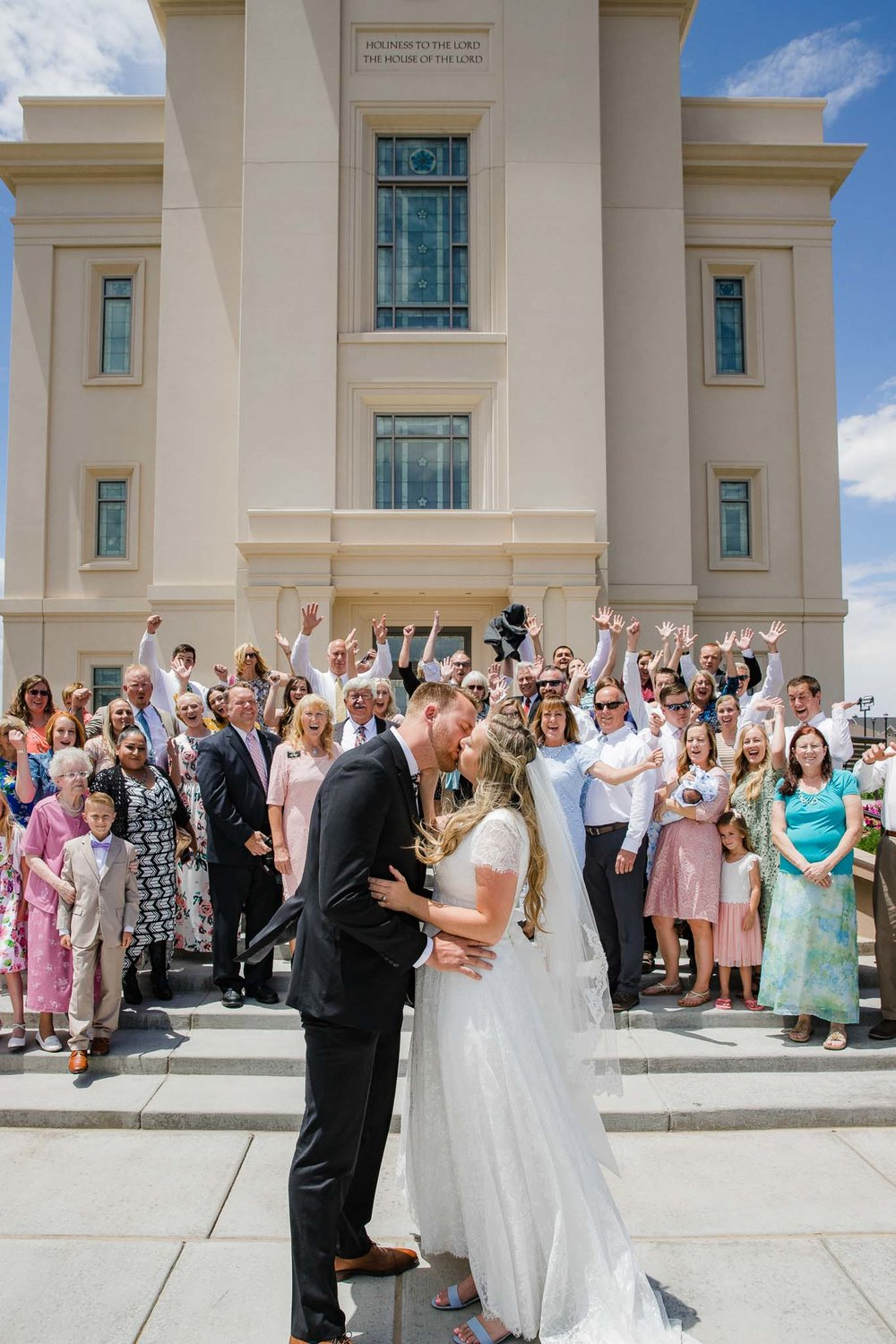 Bride and groom greet guests after Cedar City Temple wedding ceremony