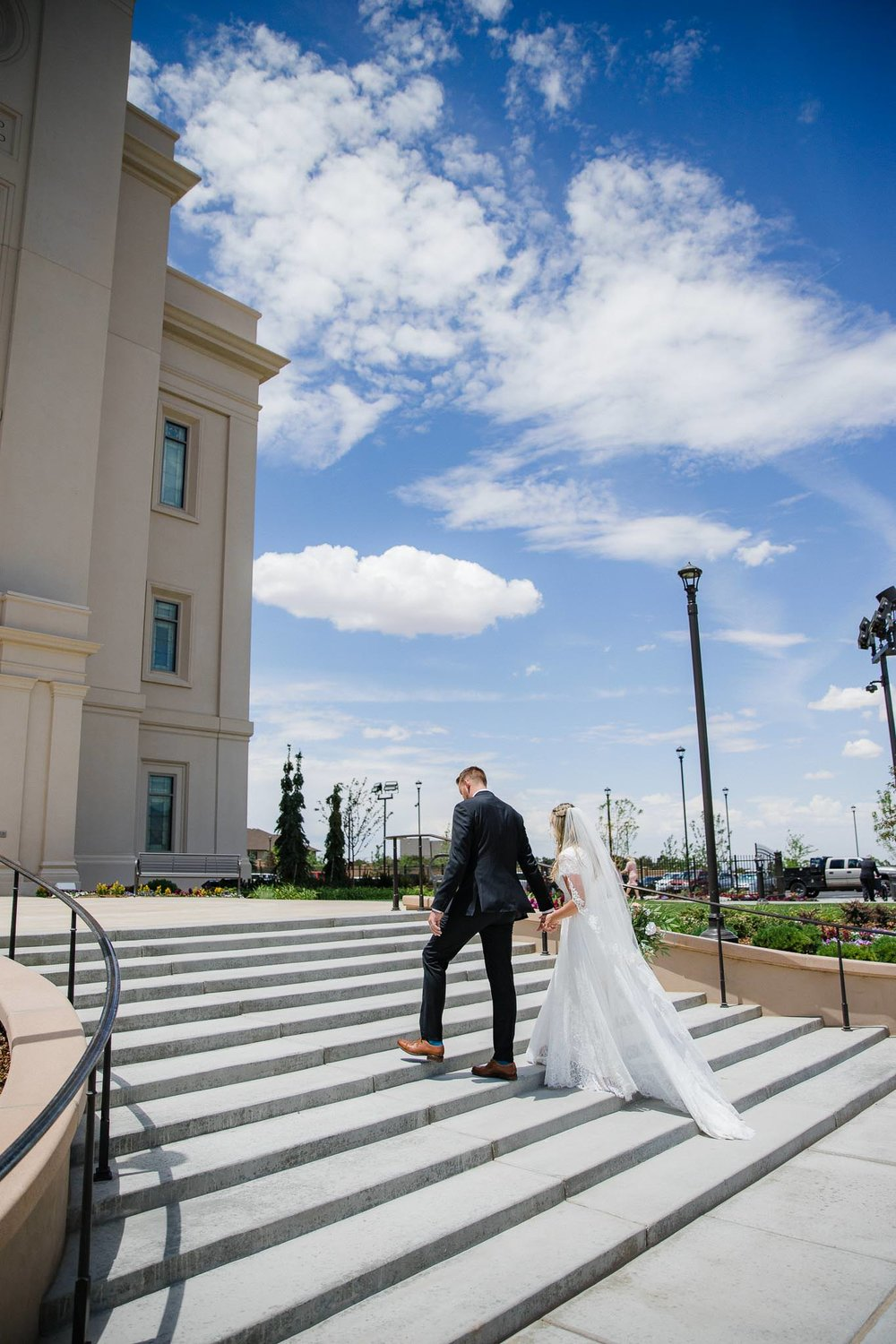 Bride and groom pose for wedding portraits at the Cedar City Temple