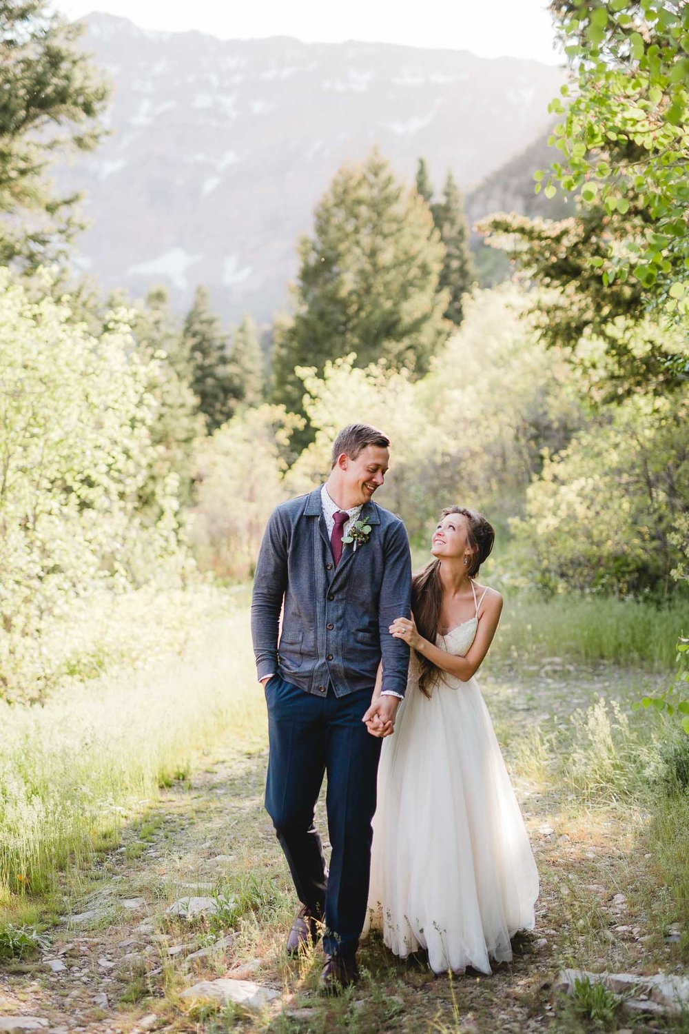 Bride and groom walk for candid portrait adventure wedding in Provo Utah