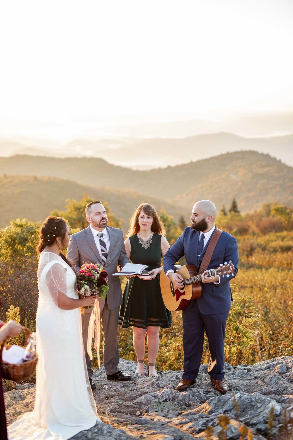 Bride and groom lead worship song at their mountain wedding ceremony on Black Balsam Knob on the Blue Ridge Parkway in Asheville North Carolina
