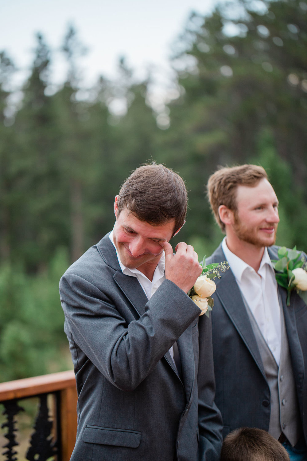 Emotional groom wipes tear first look reaction at wedding ceremony in Casper, Wyoming
