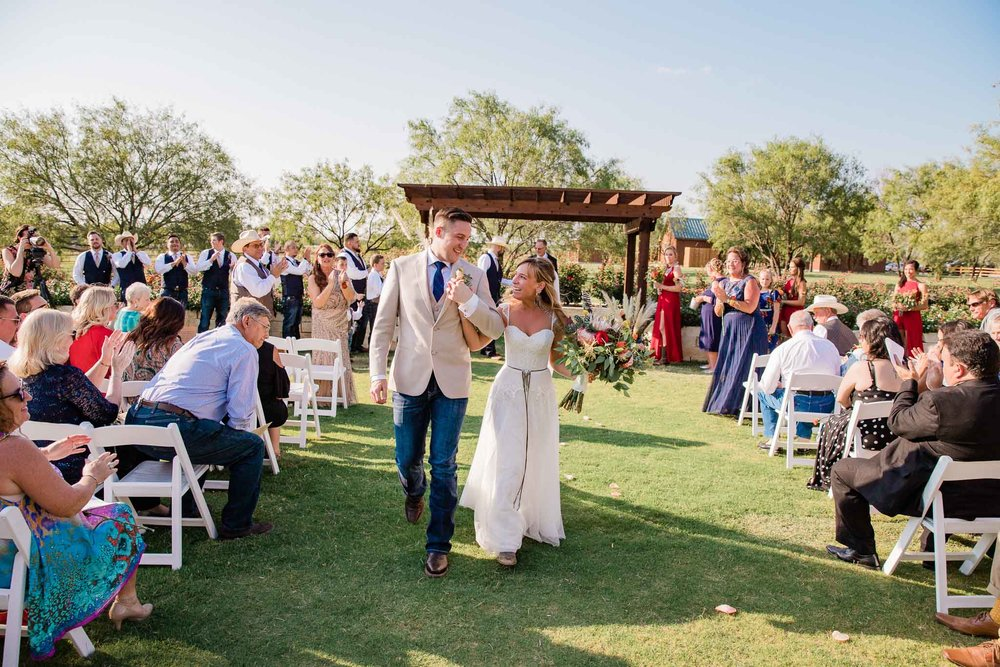 Bride and groom celebrate after wedding ceremony in Waco Texas