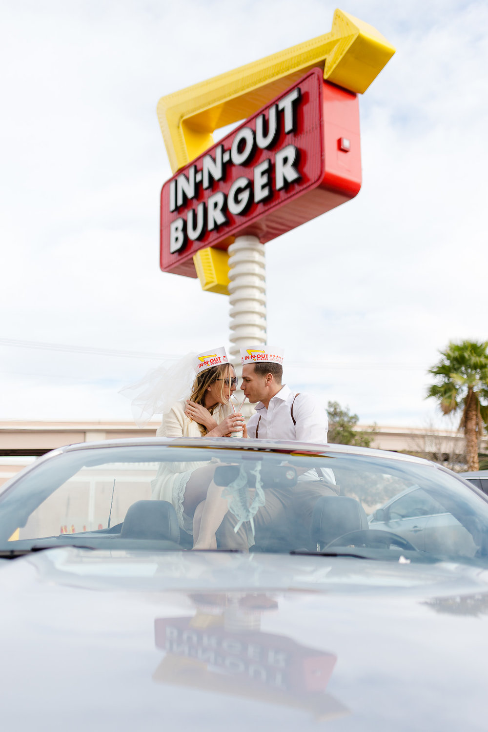 Bride and groom share a wedding shake from In-N-Out during their Las Vegas Elopement