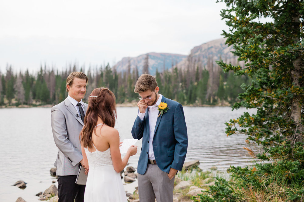 Groom wipes away a tear during Utah mountain elopement ceremony