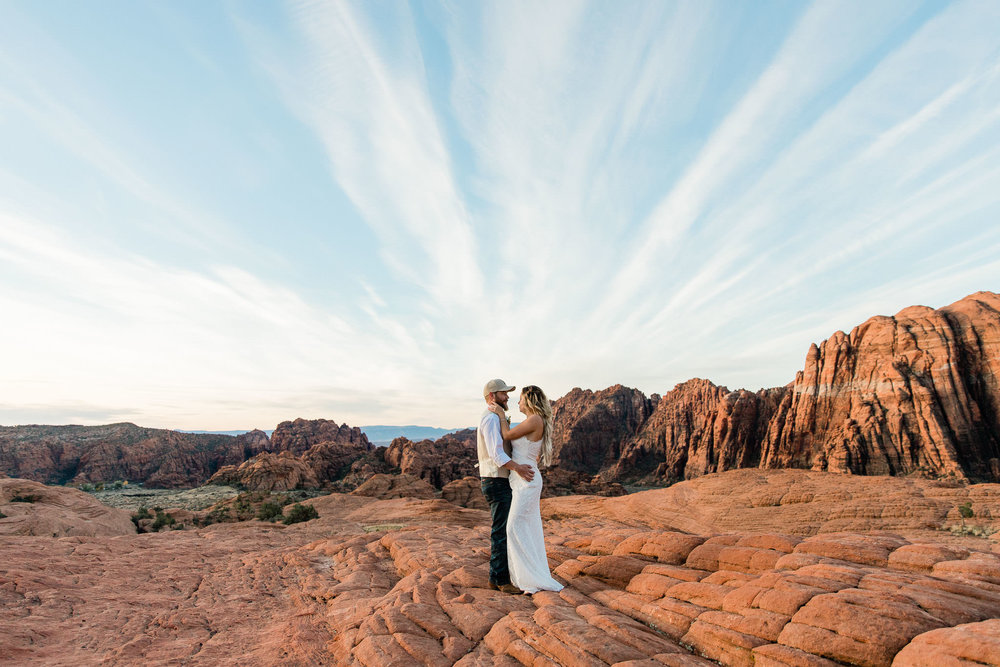 Couple stand together during their elopement in Snow Canyon State Park Utah