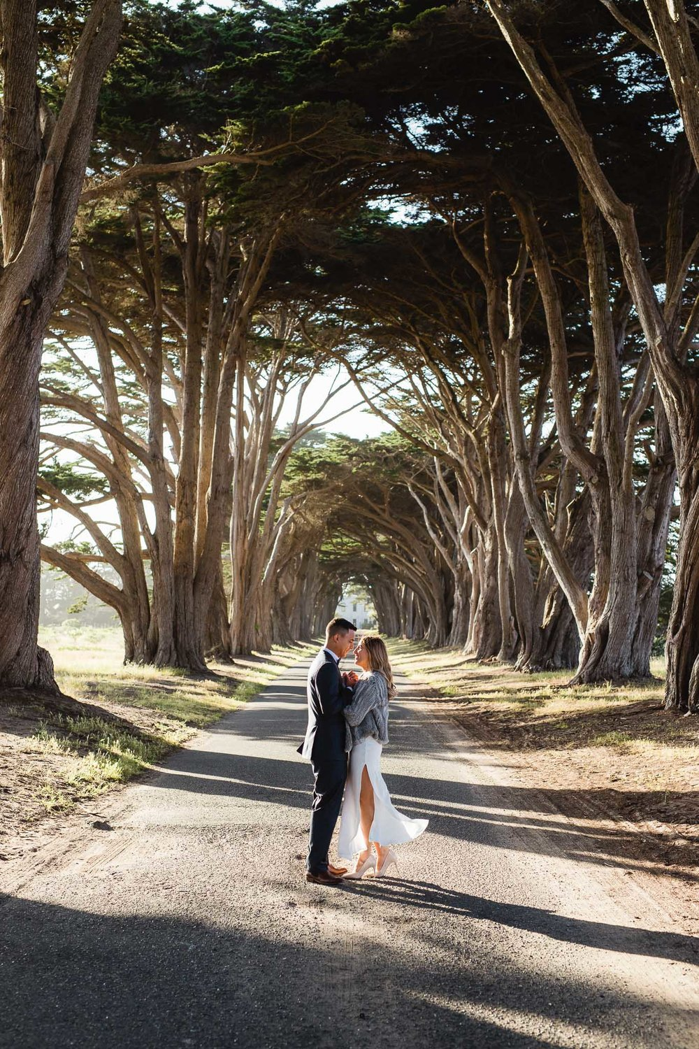 Wedding couple stand in the middle of the Cypress Tree Tunnel in Point Reyes National Seashore elopement