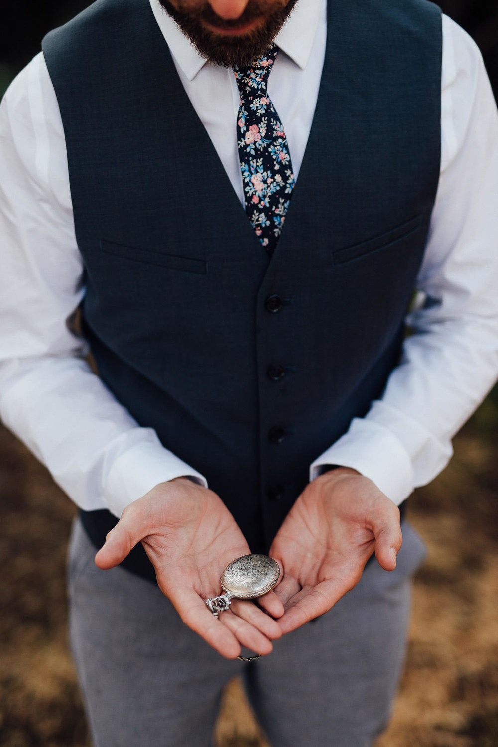 Groom holds meaningful pocket watch for his elopement in San Francisco