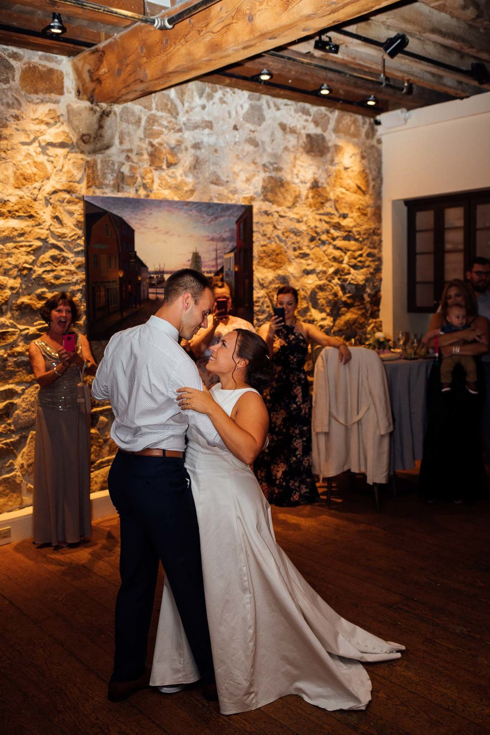 Bride and groom dance in historic building during their wedding reception in New Bedford Massachusetts