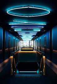 sub-urban-jackalope-hotel-neon-hallway.jpg