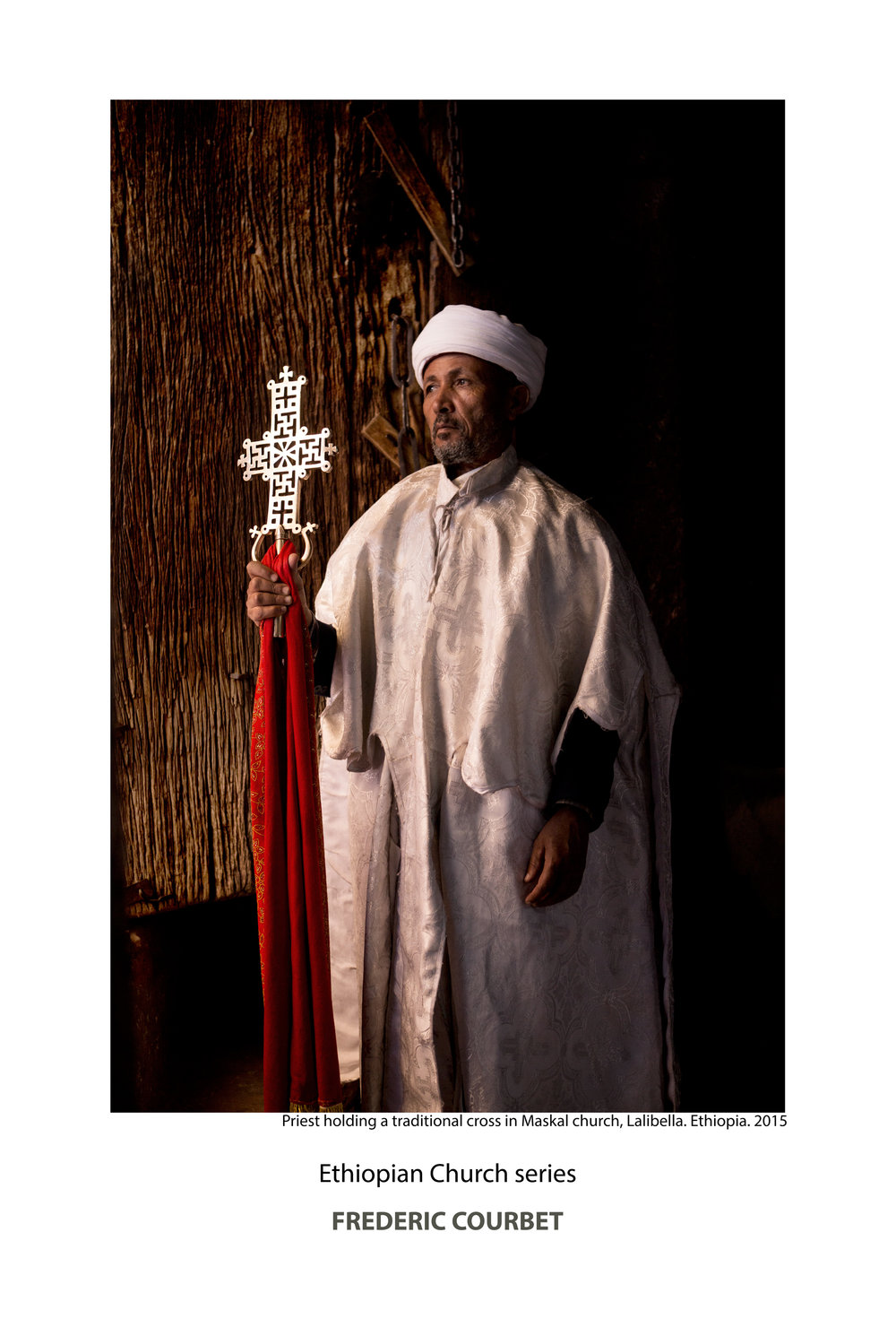 Maskal-cross-Priest-Lalibella.jpg