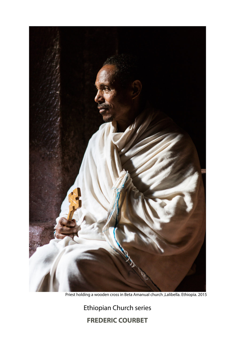 Priest-with-wooden-cross-Beta-Amanual.jpg