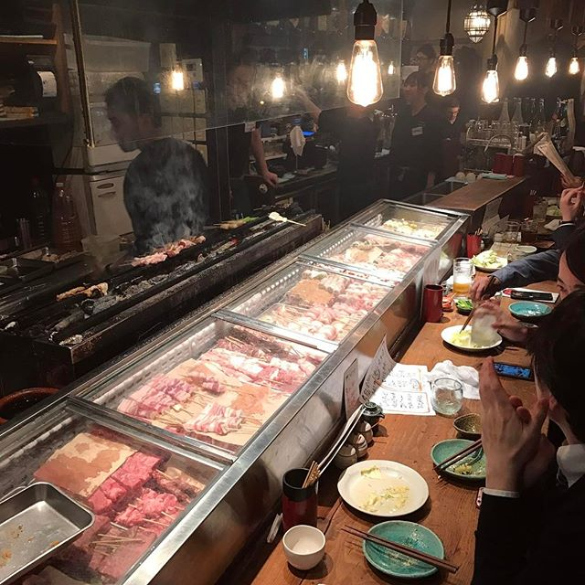 We're in Tokyo at the moment and trying to eat as much Japanese food as humanly possible. This is Joman in Roppongi, a restaurant that you can't get a table in unless you queue or reserve - and there's a reason for this; it's sensational & very reasonably priced. Luckily, they took pity on us and threw two crates up against the bar and ushered us inside the large, sliding wooden door before being asked to remove our shoes at the door - which is great, everyone shuffles around in socks. The place was small & so atmospheric, kind of like being inside the bowels of an old ship. Higgledy piggledy with raised & lowered eating levels. The cooks loudly chant lovely things, in unison, when they received an order. With the food, it's all about ordering little & many plates. Highlights include; cabbage with fermented dressing, pork belly, okonomiyaki (mouth-watering Japanese pancake), deep fried noodles wrapped in bacon, seared scallops & rare beef. Bill came to the equivalent of about €50. If you're going to Tokyo, go here for sure.