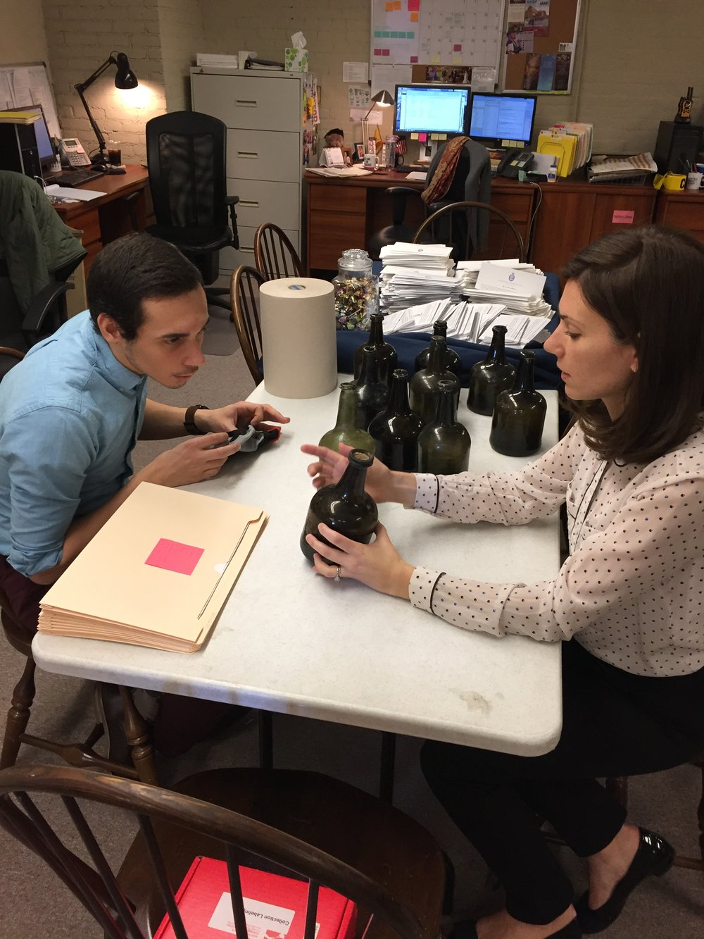 Curator Jessica Phillips and curatorial intern eli mcclain prepare to catalogue the collection.