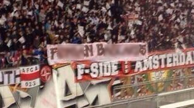 206930-ajax-fans-unfurl-an-offensive-banner-during-ajax-v-celtic.jpg
