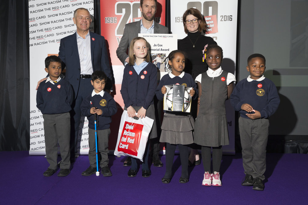 Winners of the Jo Cox Memorial Award, Elmwood Infant School Croydon, with Tim Roache, Gareth Southgate and Iona Lawrence