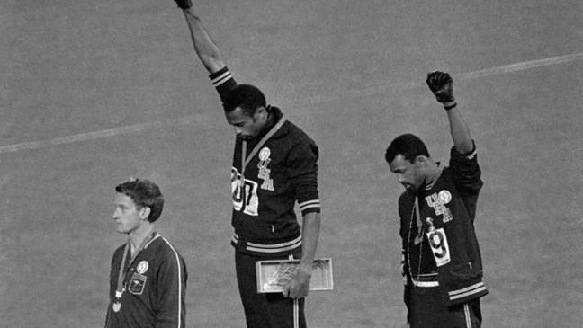 tommie-smith-and-john-carlos-give-the-black-power-salute-on-the-podium-of-the-mexico-city.jpg