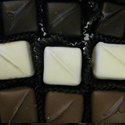 Caramels   Rich, chewy caramel covered in white, milk, or dark chocolate