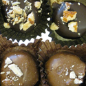Coconut Almond Bliss   Coconut cream filling covered in milk or dark chocolate, topped with crushed almonds