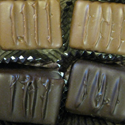 Peanut Butter Delights Rich creamy peanut butter and white confection blend coated in white, milk, or dark chocolate
