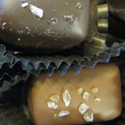 Salted Caramels   Rich, chewey caramels covered in milk ordark chocolate, sprinkled with sea salt