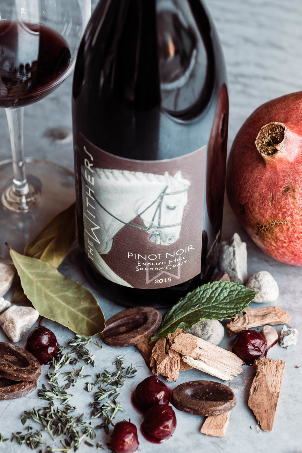 2015 English Hill Pinot Noir  Notes of chocolate, dark cherries, herbs, pomegranate, oak