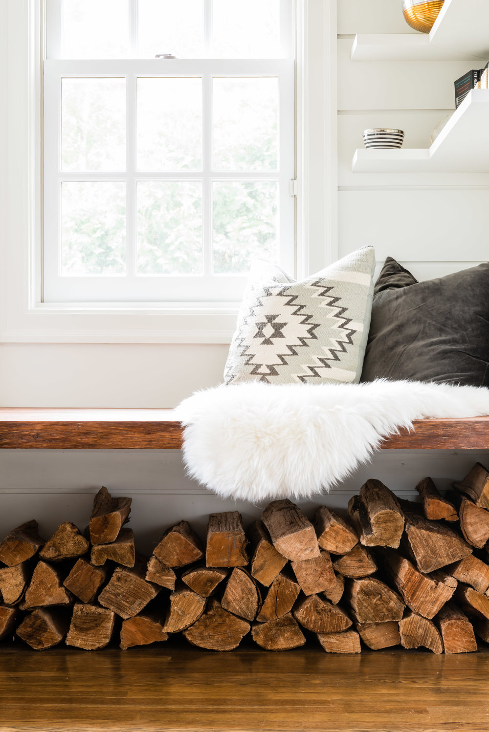 I wish I could take credit for the woodpile under the custom walnut floating seat….but I can't. My client did this one day and it blew my mind!
