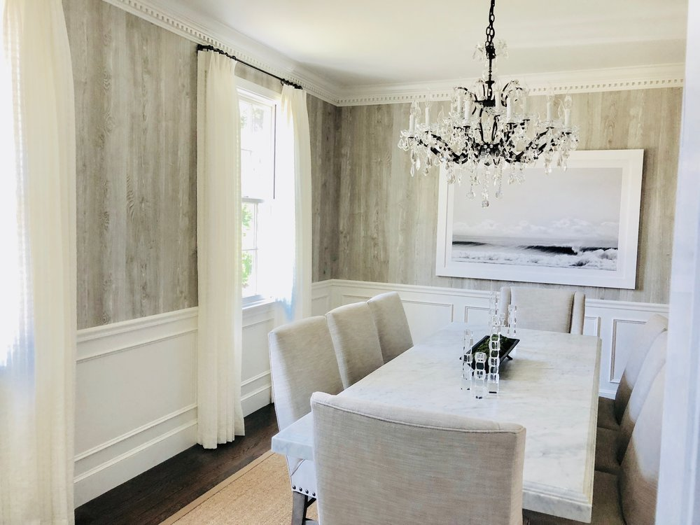 Faux wood wallpaper wraps the walls and is offset by the crystal and iron chandelier. Dining table is carerra marble…yep that's right…I'll say it again…marble!!