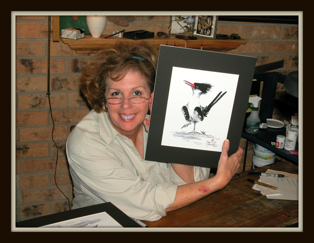 Duckie - Wild Bird Painter / Master Jeweler   Our Duckie - Cherie Nowlin McBride - is the artistic fuel powering Duckie and the Grackle Gallery and Jewelry Studio. Duckie creates stunning wild bird paintings that reside in homes across Texas. In addition, Duckie is a master jeweler, having built years of experience and trust in her home town.  Duckie was born to paint! Her wild bird images began making a stir in 2004. We invite you to browse her paintings and pick your favorites.