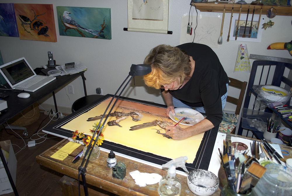 duckie painting roadrunners in studio.jpg
