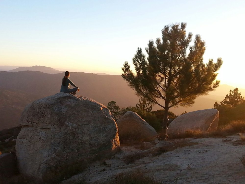 Inspiration Point - Idyllwild, CA - Linda sitting atop a boulder overlooking some of Southern California's mountain ranges.
