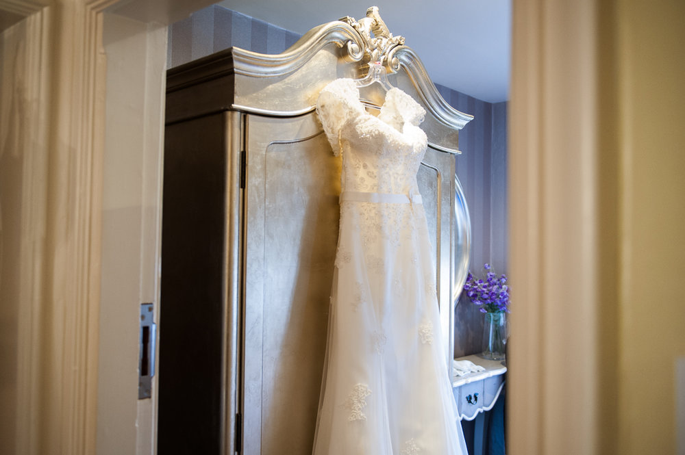 Brides dress hanging on the wardrobe at Eaves Hall.