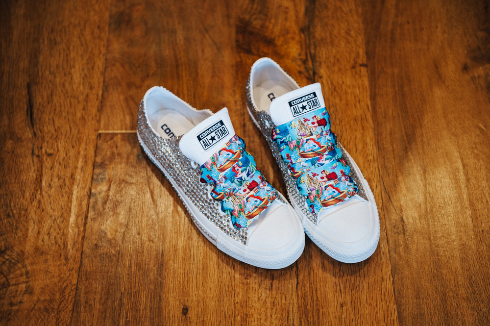 Quirky wedding shoes made by the bride. Converse with bling and Disney themed shoe laces. Lancashire wedding photography