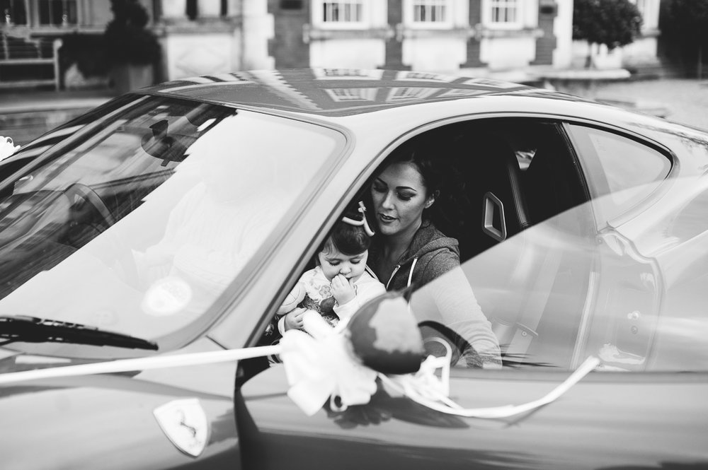Bride arriving at Eaves Hall in Ferrari. Lancashire wedding photography