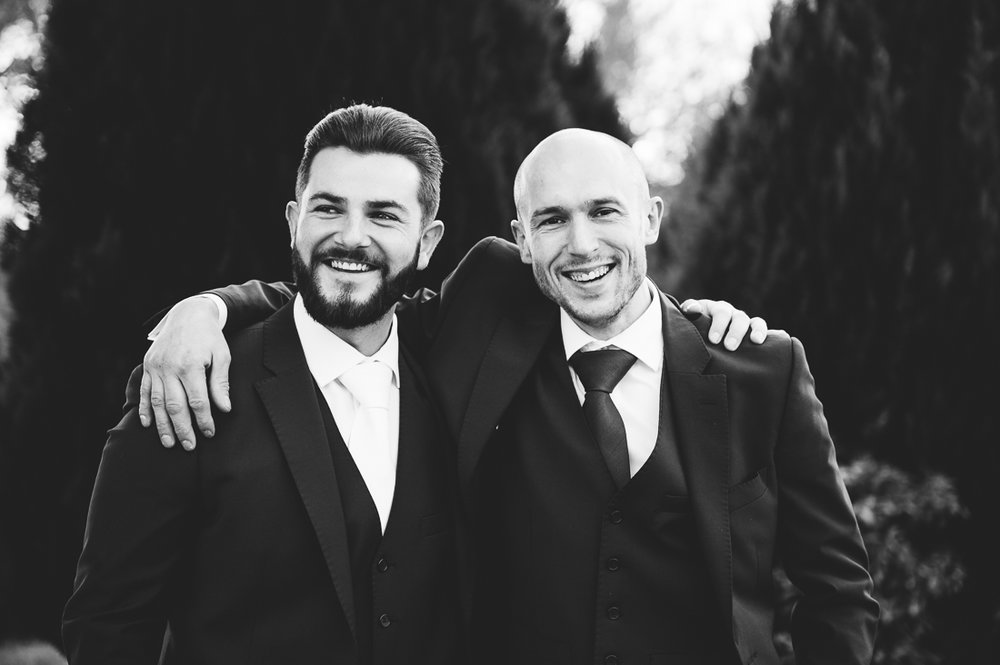 Natural black and white shot of the Groom and best man. Eaves Hall wedding photography