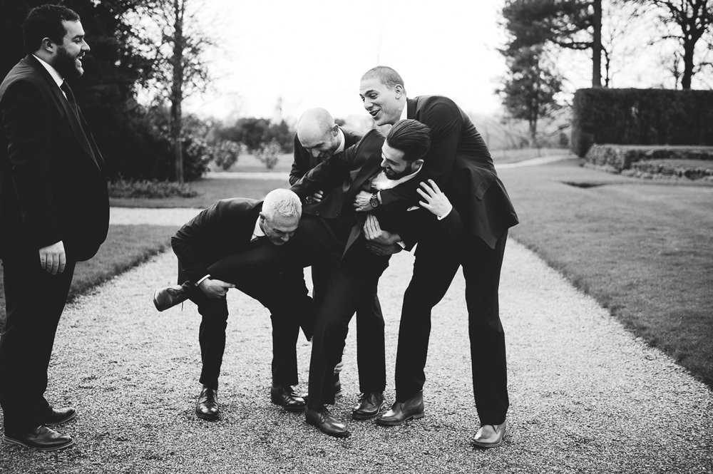 Groomsmen picking up Groom